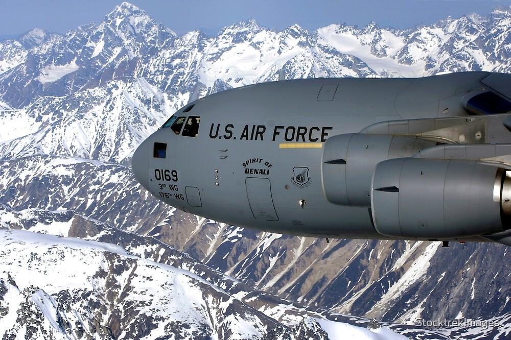 The Spirit of Denali flies over the Alaska Range. by StocktrekImages