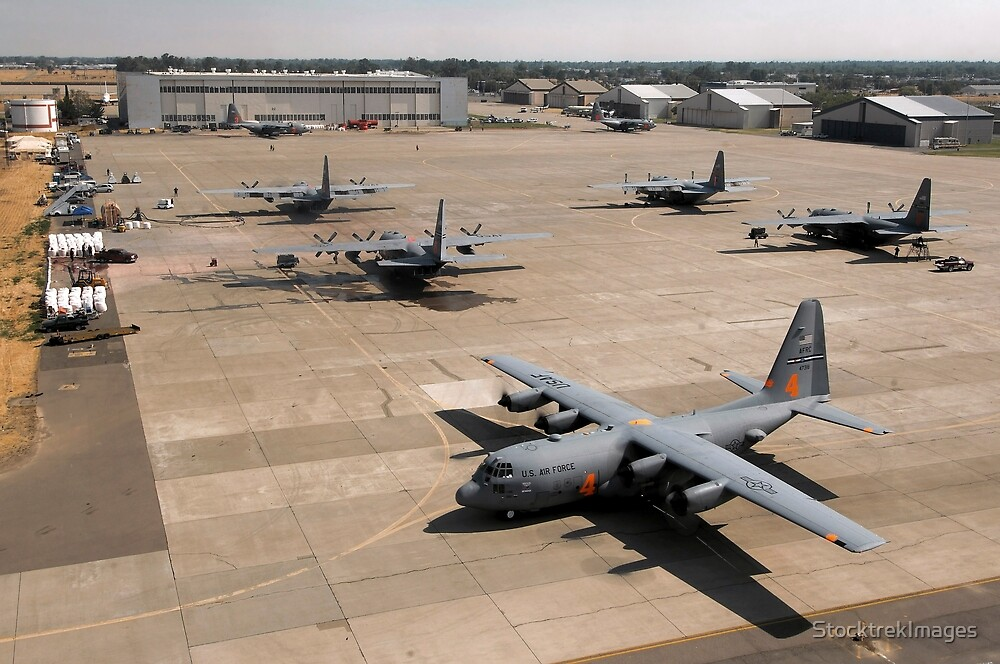 C-130 Hercules aircraft stationed at an airbase. by StocktrekImages