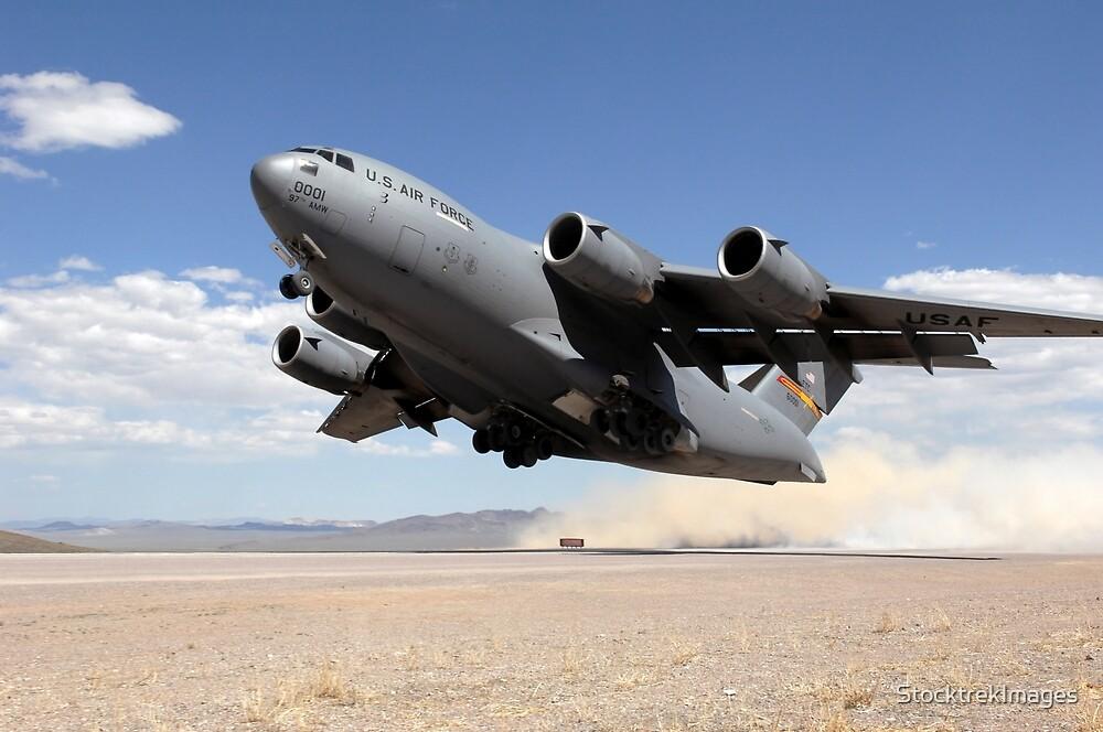A C-17 Globemaster departs from the Tonopah runway. by StocktrekImages