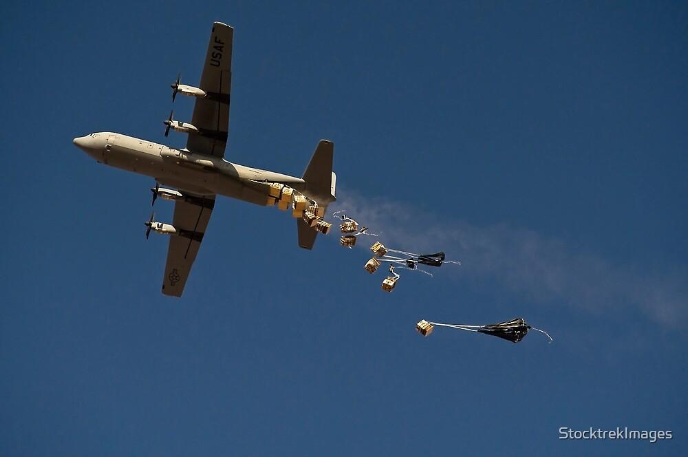 A U. S. Air Force C-130 Hercules airdrops 20 bundles over Afghanistan. by StocktrekImages