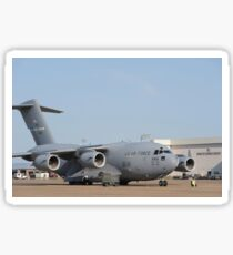 A C-17 Globemaster III parked on the ramp at an Air Force base. Sticker