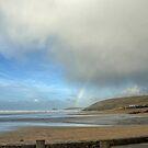 Start of a Rainbow at Perranporth,Cornwall, UK by lynn carter