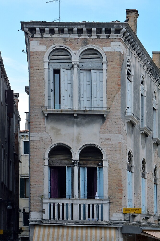 Old narrow building in Venice, Italy with arches and columns by oanaunciuleanu