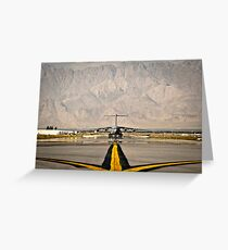 A C-17 Globemaster III taxis to its parking spot at Bagram Airfield. Greeting Card