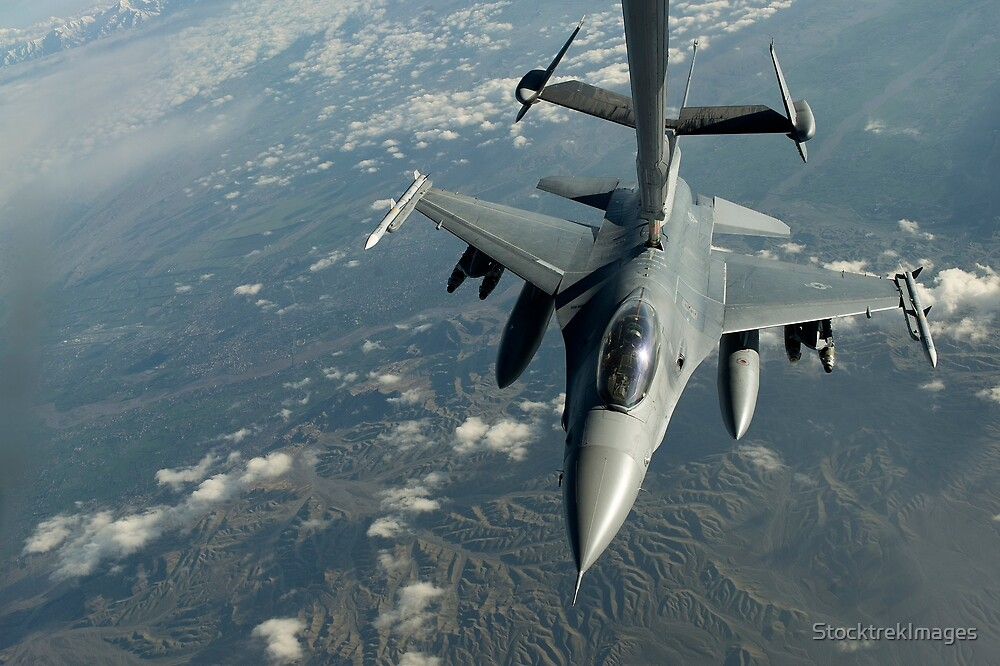 A U.S. Air Force F-16C Fighting Falcon conducts aerial refueling. by StocktrekImages