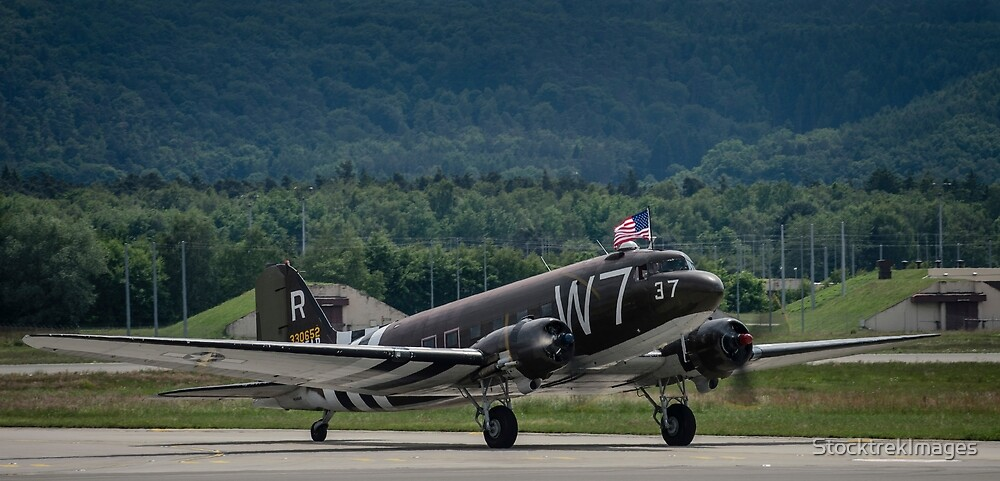 A U.S. Air Force C-47 Skytrain aircraft lands at Ramstein Air Base, Germany. by StocktrekImages