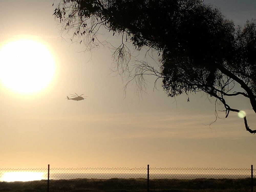 Helicopter Flying California Shoreline by theveiledattic