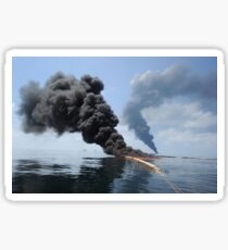 Dark clouds of smoke and fire emerge as oil burns during a controlled fire in the Gulf of Mexico. Sticker