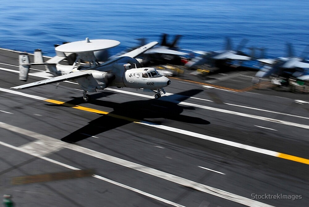 An E-2C Hawkeye lands aboard the aircraft carrier USS John C. Stennis. by StocktrekImages