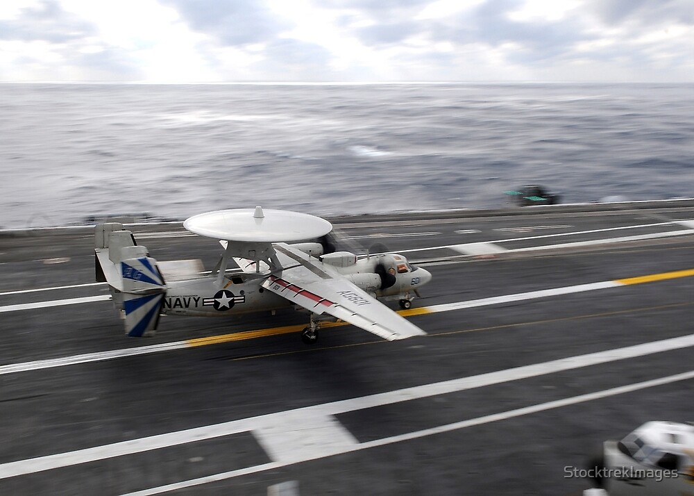 An E-2C Hawkeye conducts a touch-and-go landing aboard USS Dwight D. Eisenhower. by StocktrekImages
