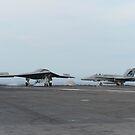 Ein X-47B unbemanntes Kampfluftsystem führt eine Landung aus. von StocktrekImages