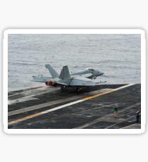 An F/A-18E Super Hornet launches from the flight deck of USS Nimitz. Sticker