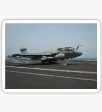 An EA-6B Prowler lands on the flight deck of USS Nimitz. Sticker