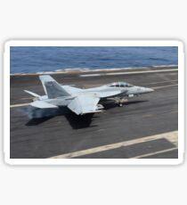 An F/A-18F Super Hornet lands on the flight deck of USS Nimitz. Sticker