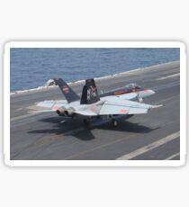 An F/A-18E Super Hornet lands on the flight deck of USS Nimitz. Sticker