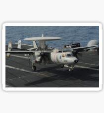 An E-2C Hawkeye lands aboard the aircraft carrier USS Nimitz. Sticker