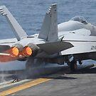 Eine F / A-18E Super Hornet startet von der USS Nimitz. von StocktrekImages