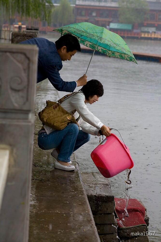 A rainy day - To buy captive fish and set them free by maka1967