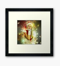 Blonde woman with Santa Hat Framed Print
