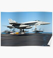 An F/A-18E Super Hornet lands on the flight deck of USS Harry S. Truman. Poster