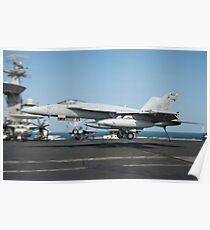 An F/A-18E Super Hornet lands aboard USS Harry S. Truman. Poster