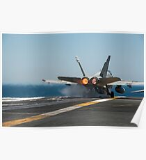 An F/A-18C Hornet launches from the flight deck of USS Carl Vinson. Poster