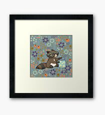 Funny little raccoon collects crickets Framed Print