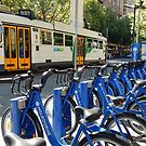 Melbourne Tram & Tourist Bicycles, Melbourne Australia by Evelyn Hood