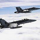 Zwei F / A-18C Hornets fliegen über die Pacific Missile Range Facility. von StocktrekImages