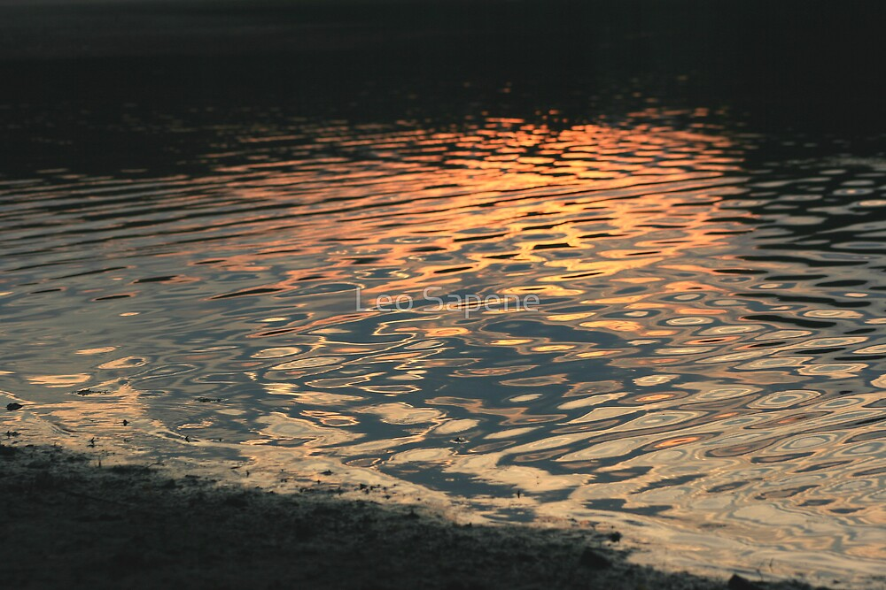 Sunset reflection on water by Leo Sapene