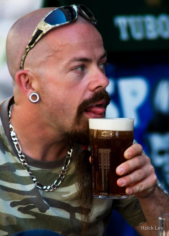 Enjoying a beer  by Itzick Lev