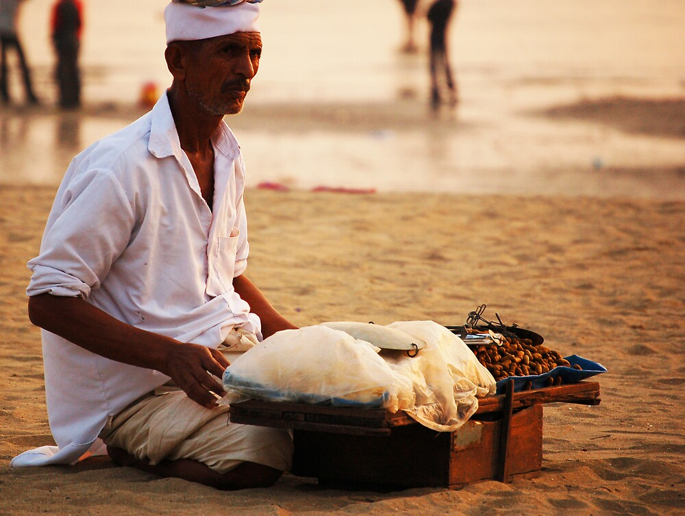 Vendor and the Beach by Desmond  Wilson