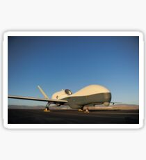 An RQ-4 Global Hawk unmanned aerial vehicle sits on the flight line. Sticker