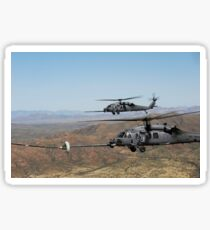 Two HH-60 Pave Hawks refuel over the desert surrounding Davis-Monthan Air Force Base, Arizona. Sticker