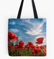 poppy flowers field in mountains Tote Bag