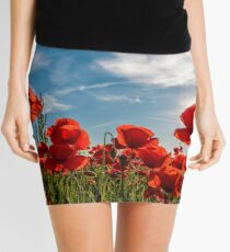 poppy flowers field in mountains Mini Skirt