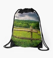 wooden fence on the hillside Drawstring Bag