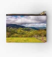 wooden fence on the hillside Studio Pouch
