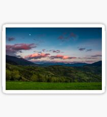 countryside landscape in mountains at dusk and moonrise Sticker