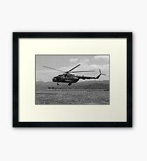 A Macedonian MI-17 helicopter landing as part of a medical transport flight. Framed Print