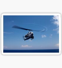 An AH-1 Cobra in flight over the Philippine Sea. Sticker