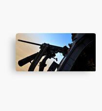 Soldier mans the .50 caliber machine gun on a HH-60G Pave Hawk. Canvas Print
