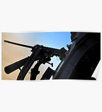 Soldier mans the .50 caliber machine gun on a HH-60G Pave Hawk. Poster