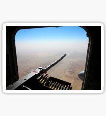 A .50 caliber machine gun aims outboard of a CH-53E Super Stallion. Sticker