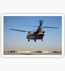 A CH-47 Chinook helicopter prepare to land. Sticker