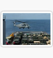 A CH-53E Super Stallion prepares to land on the flight deck of USS Ashland. Sticker
