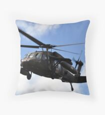 A UH-60 Black Hawk helicopter taking off. Throw Pillow