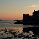 Eilean Donan Castle at Sunset in silhouette by Maria Gaellman