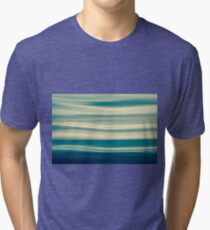 Blue tones on coastal abstract wavy clouds over horizon Tri-blend T-Shirt