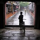 Waiting for the rain to stop, Hoi An by Traveldreams